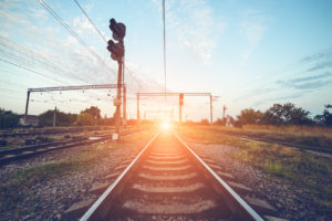 Train platform and traffic light at sunset. Railroad. Railway station